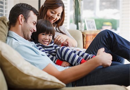 Family relaxing together on sofa Stock Photo - Premium Royalty-Free, Code: 635-05972040
