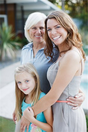 Three generations of women smiling together Stock Photo - Premium Royalty-Free, Code: 635-05972042