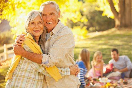 Older couple hugging outdoors Stock Photo - Premium Royalty-Free, Code: 635-05972056