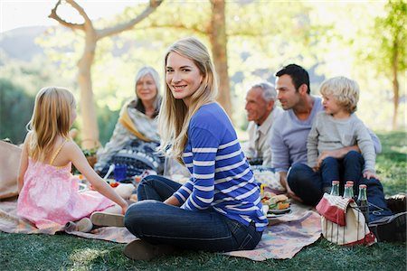 Family picnicking together on grass Stock Photo - Premium Royalty-Free, Code: 635-05972053