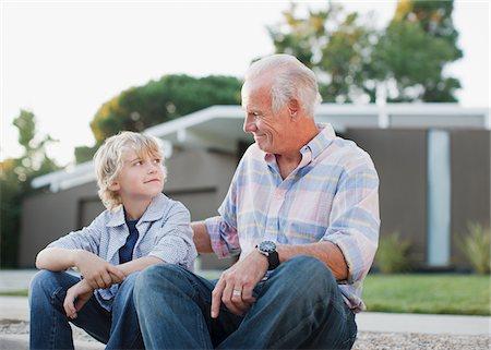 preteens pictures older men - Older man and grandson sitting together Stock Photo - Premium Royalty-Free, Code: 635-05972068