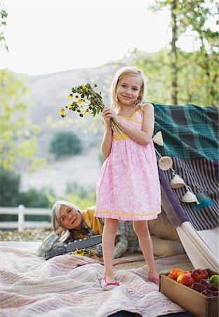 dece11 - Girl holding bunch of flowers on blanket Stock Photo - Premium Royalty-Free, Code: 635-05972069