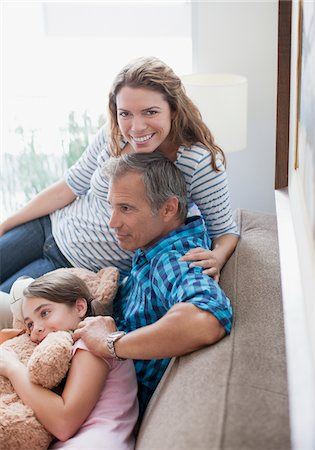 Family relaxing on sofa together Stock Photo - Premium Royalty-Free, Code: 635-05972061