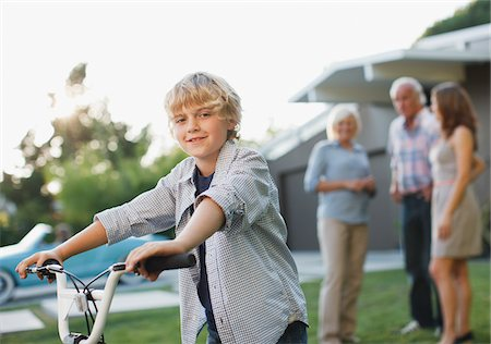 Boy riding bicycle outdoors Stock Photo - Premium Royalty-Free, Code: 635-05972062