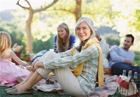 Family picnicking together outdoors Stock Photo - Premium Royalty-Free, Code: 635-05972076