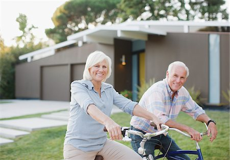 Older couple riding bicycles together Stock Photo - Premium Royalty-Free, Code: 635-05972084