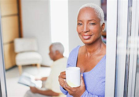 Older woman having cup of coffee Stock Photo - Premium Royalty-Free, Code: 635-05972099