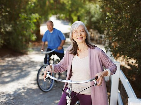 Smiling older couple riding bicycles Stock Photo - Premium Royalty-Free, Code: 635-05972115