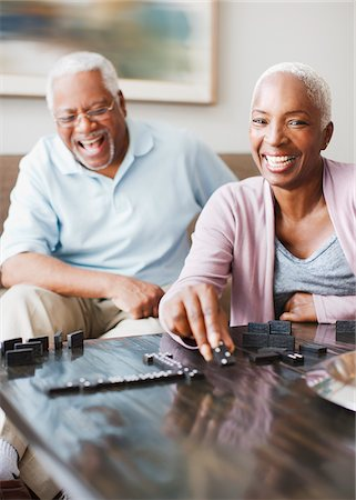 Laughing older couple playing dominoes Stock Photo - Premium Royalty-Free, Code: 635-05972111