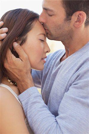 Couple kissing outdoors Stock Photo - Premium Royalty-Free, Code: 635-05972128