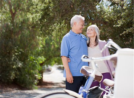 Smiling older couple hugging outdoors Stock Photo - Premium Royalty-Free, Code: 635-05972137