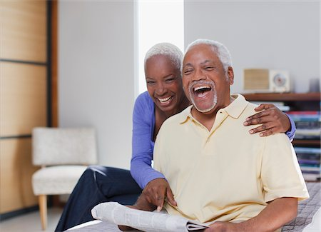 Older couple laughing together indoors Stock Photo - Premium Royalty-Free, Code: 635-05972140