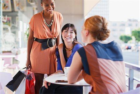 Smiling women talking in cafe Stock Photo - Premium Royalty-Free, Code: 635-05972176