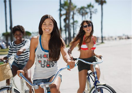 Women riding bicycles together Stock Photo - Premium Royalty-Free, Code: 635-05972173