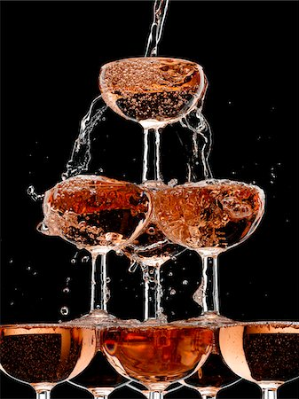 Champagne pouring into stacked glasses Stock Photo - Premium Royalty-Free, Code: 635-05972246