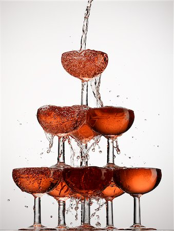 Champagne pouring into stacked glasses Stock Photo - Premium Royalty-Free, Code: 635-05972248