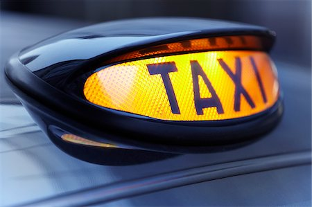 Close up of lit taxi sign Stock Photo - Premium Royalty-Free, Code: 635-05972256