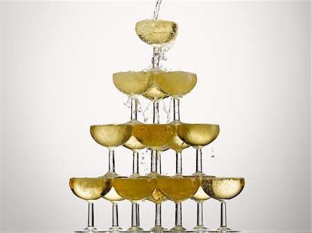 Champagne pouring into stacked glasses Stock Photo - Premium Royalty-Free, Code: 635-05972251