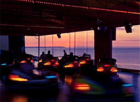 Time lapse view of bumper cars at sunset Stock Photo - Premium Royalty-Free, Code: 635-05972272