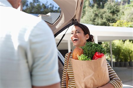 Woman unloading groceries from car Stock Photo - Premium Royalty-Free, Code: 635-05972309