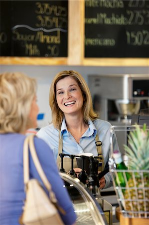 Server in supermarket talking with customer Stock Photo - Premium Royalty-Free, Code: 635-05972312
