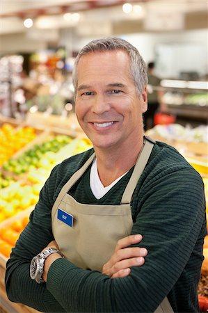 short hair - Worker smiling in supermarket Stock Photo - Premium Royalty-Free, Code: 635-05972324