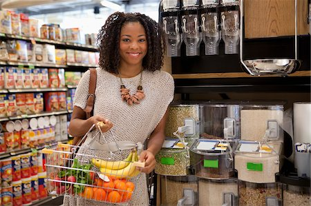Woman shopping in supermarket Stock Photo - Premium Royalty-Free, Code: 635-05972326