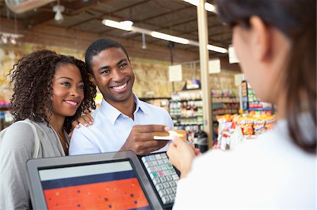 Couple buying groceries in supermarket Stock Photo - Premium Royalty-Free, Code: 635-05972375