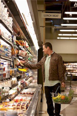 Man shopping in supermarket Stock Photo - Premium Royalty-Free, Code: 635-05972377