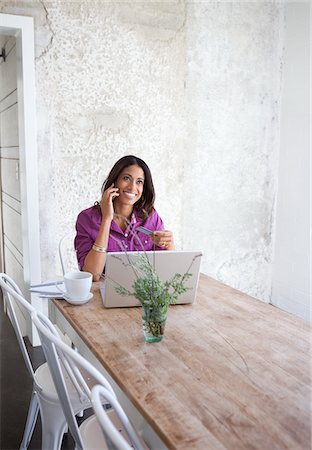 person on phone with credit card - Woman talking on cell phone at computer Stock Photo - Premium Royalty-Free, Code: 635-05972370