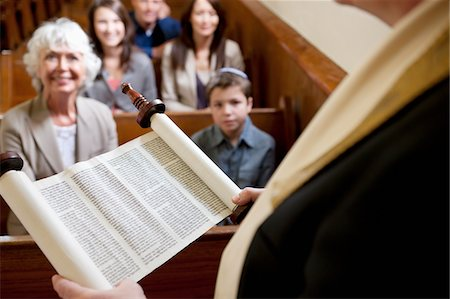 Rabbi reading from Torah scrolls in synagogue Stock Photo - Premium Royalty-Free, Code: 635-05972410