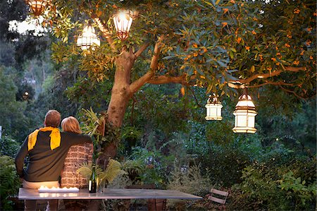 Couple relaxing in garden at twilight Stock Photo - Premium Royalty-Free, Code: 635-05972440