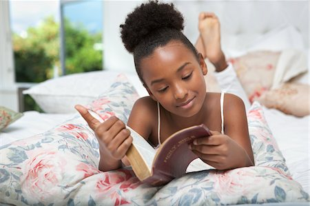 Girl reading Bible in bed Stock Photo - Premium Royalty-Free, Code: 635-05972472