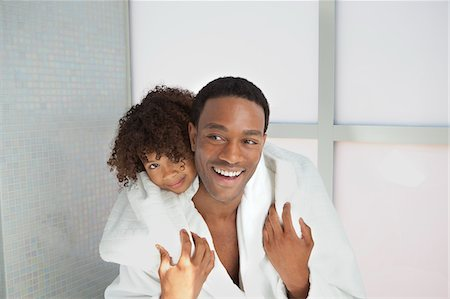 Father and son playing in bathroom Stock Photo - Premium Royalty-Free, Code: 635-05972509