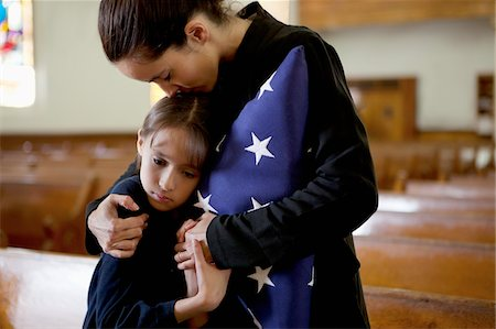 dead woman - Mother and daughter hugging at military funeral Stock Photo - Premium Royalty-Free, Code: 635-05972510