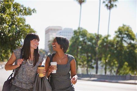 Businesswomen walking together outdoors Stock Photo - Premium Royalty-Free, Code: 635-05972549