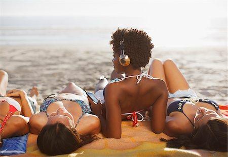 Women sunbathing together on beach Stock Photo - Premium Royalty-Free, Code: 635-05972591