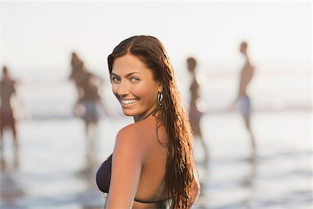 Woman wearing bikini on beach Stock Photo - Premium Royalty-Free, Code: 635-05972602