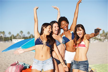 Women taking picture of themselves on beach Stock Photo - Premium Royalty-Free, Code: 635-05972603