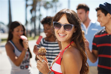 Woman eating ice cream cone outdoors Stock Photo - Premium Royalty-Free, Code: 635-05972646