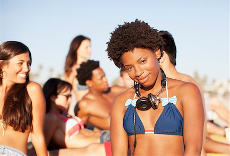 Woman wearing headphones on beach Stock Photo - Premium Royalty-Free, Code: 635-05972642