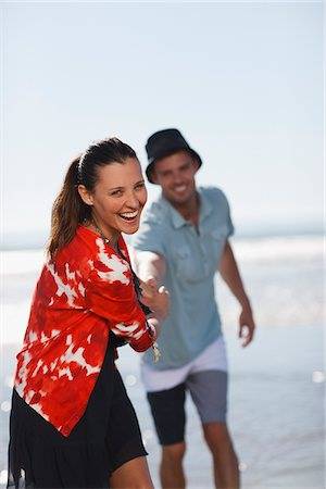 Couple walking together on beach Stock Photo - Premium Royalty-Free, Code: 635-05972667