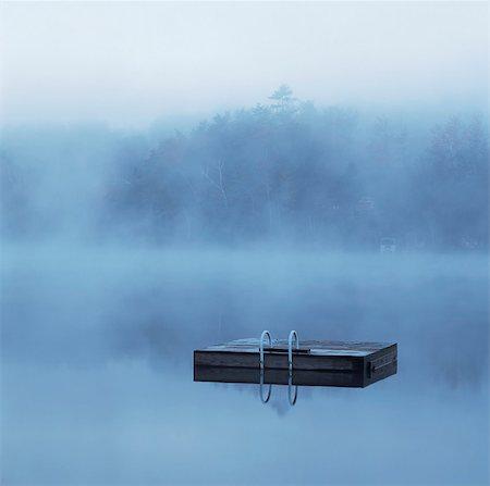 platform - Wooden dock floating in still lake Stock Photo - Premium Royalty-Free, Code: 635-05972709