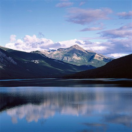 Rocky mountains and sky reflected in still lake Stock Photo - Premium Royalty-Free, Code: 635-05972725