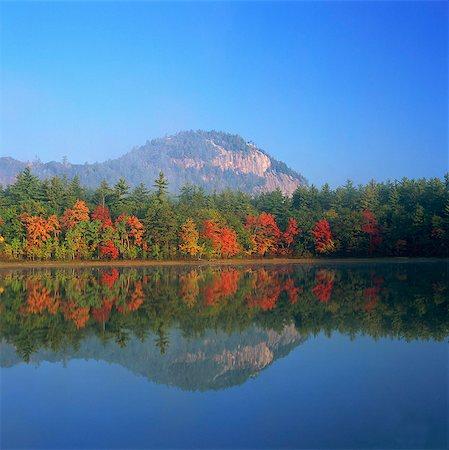 fall trees lake - Autumn trees reflected in still lake Stock Photo - Premium Royalty-Free, Code: 635-05972826