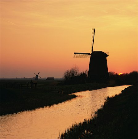 Silhouette of windmill and river in rural landscape Stock Photo - Premium Royalty-Free, Code: 635-05972870