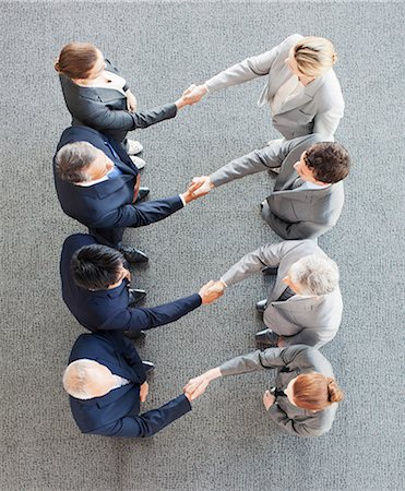 High angle view of business people shaking hands in a row Stock Photo - Premium Royalty-Free, Code: 635-06045027