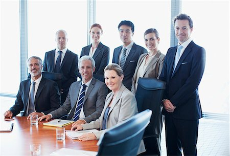Portrait of smiling business people in conference room Stock Photo - Premium Royalty-Free, Code: 635-06045029