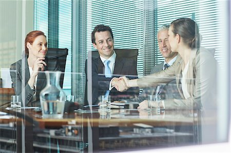 Business people shaking hands at table in conference room Stock Photo - Premium Royalty-Free, Code: 635-06045037