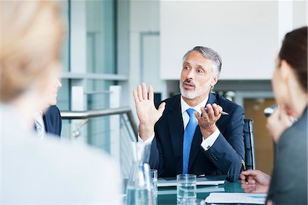 Gesturing businessman leading meeting in conference room Stock Photo - Premium Royalty-Free, Code: 635-06045038